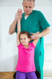 pic of chiropractor  - Chiropractor doing adjustment on female patient - JPG
