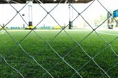 pic of nylons  - green nylon net on football field background photo - JPG