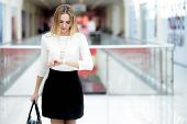 Постер, плакат: Young Business Woman In A Rush Glancing At Time On Wristwatch