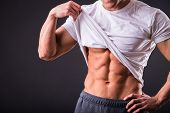 stock photo of abdominal muscle man  - Abdominal muscles strong man - JPG