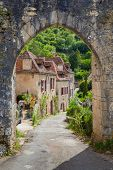 stock photo of naturel  - Arched entrance at Saint Circ Lapopie in France - JPG