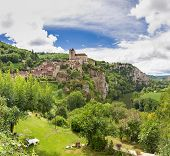 stock photo of naturel  - Village of Saint Circ Lapopie in France against a blue sky - JPG