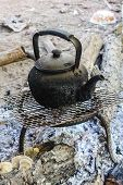 pic of boiling water  - Old Kettle Boiling Water For Coffee Or Tea In Countryside In Thailand - JPG