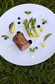 foto of veal  - Piece of veal asparagus herbs and sauce - JPG