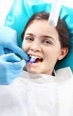 stock photo of sandblasting  - Child in the dental chair dental treatment during surgery - JPG