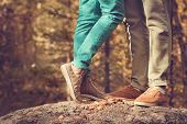stock photo of legs feet  - Couple Man and Woman Feet in Love Romantic Outdoor Lifestyle with nature on background Fashion trendy style - JPG