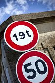 image of nineteen fifties  - Two road signs on a stone wall - JPG