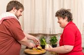 picture of handicapped  - a handicapped woman and a young man in the kitchen - JPG