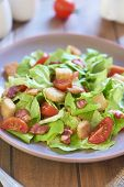 stock photo of smoked ham  - Caesar salad with grilled smoked ham and cherry tomatoes