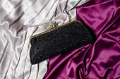pic of clutch  - The black clutch on a silk background - JPG
