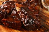 stock photo of ribs  - Baby pork or beef ribs with barbecue sauce - JPG