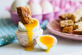 picture of boil  - Series on boiled duck egg for breakfast with toast soldiers - JPG