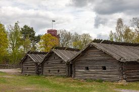 picture of shadoof  - typical swedish wooden houses  - JPG