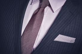 image of lapel  - Closeup of elegant formal business suit with dark grey jacket with handkerchief in the pocket shirt and necktie - JPG