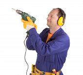 image of muff  - Worker in ear muffs with drill - JPG
