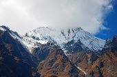 picture of mountain chain  - Mountain peak in a fog - JPG