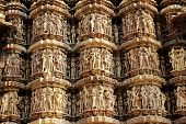 stock photo of khajuraho  - Exquisite wall carvings at Kandariya Mahadev Temple under Western Group of Temples in Khajuraho Madhya Pradesh India Asia - JPG