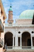 stock photo of vicenza  - Perspective of the famous Clock Tower of Vicenza with the Palladian Basilica and its typical statues - JPG