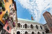 foto of vicenza  - The palladian Basilica and some colored palaces of the town center of Vicenza seen from Piazza delle Erbe  - JPG