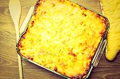 image of lasagna  - Lasagna with crispy cheese crust in the form of a glass baking - JPG