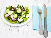 stock photo of radish  - Spring salad with eggs cucumbers and radish on a wooden background - JPG