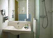 foto of wash-basin  - The equipment of the room with a wash basin and a shower - JPG