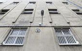 pic of prison uniform  - Prison walls surrounds walking yard in prison - JPG
