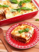 pic of lasagna  - Classic italian Lasagna Bolognese on a red plate - JPG