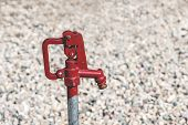 foto of water well  - Rustic red water well dripping water shallow DOF - JPG