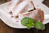 picture of pound cake  - ring cake sprinkled with sugar on old wooden table - JPG