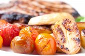 stock photo of pork chop  - grilled pork chop ith greek potatoes and roasted tomatoes - JPG