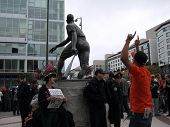 Giants Fans Celebrating Winning Division In Willie Mays Plaza With San Francisco Police Officers Wat