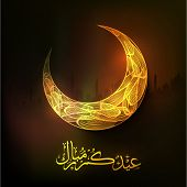 picture of moon silhouette  - Golden crescent moon and Arabic Islamic calligraphy of text Eid Mubarak on Mosque silhouette background for Muslim community festival celebration - JPG