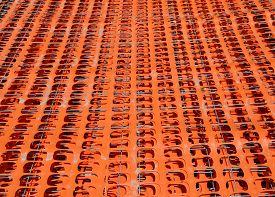 stock photo of safety barrier  - Orange Safety Fence Barrier Visual Barrier used in construction sites and crowd control - JPG