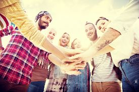 picture of huddle  - Friends Huddle Join Holiday Party Group Concept - JPG