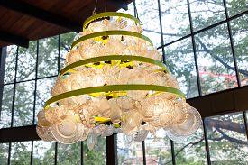 stock photo of lamp shade  - Creative lamp warm tone made from glass plates  - JPG