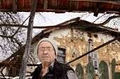 stock photo of centenarian  - Old man in front of his village house - JPG