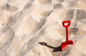 stock photo of shoulder-blade  - Children red blade in the sand on the beach - JPG