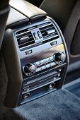 Modern Luxury Car Climate Control Panel For Passengers In The Rear Row With Shallow Depth Of Field.  poster