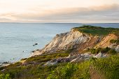 Sandy Cliffs Of Moshup Beach On Marthas Vinyard Island As Sun Begins To Set poster