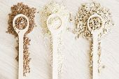 Three Kinds Of Seeds In The Wooden Spoon.sesame Seeds,sunflower Seeds,flax Seeds poster