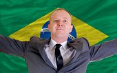 Happy Businessman Because Of Profitable Investment In Brazil Standing Near Flag