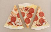 Pepperoni Pizza Slices Isolated On Empty Brown Craft Paper Background Top View. Simple Fast Food Ban poster