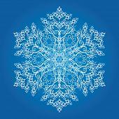 Single detailed snowflake on light blue background