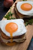French croque madame sandwich with ham, cheese and fried egg poster