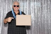 man with blank sign. A Man in a Photo Booth with a Blank Sign. Room for text. Silver sequin backgrou poster