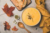 Pumpkin Cream Soup In Bowl On Concrete Background. Vegan Vegetarian Pumpkin Soup. Autumn Comfort Foo poster