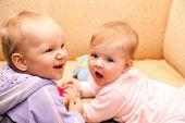 Two Babies Playing On Sofa.