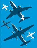 Airplane silhouettes in two colors.