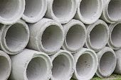 Stacked Cement Pipes At Concrete Factory Manholes Are Stored On The Ground Ready For  Industrial Bui poster